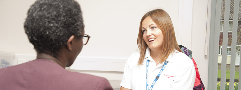 An Adult Speech and Language Therapist talks to a patient